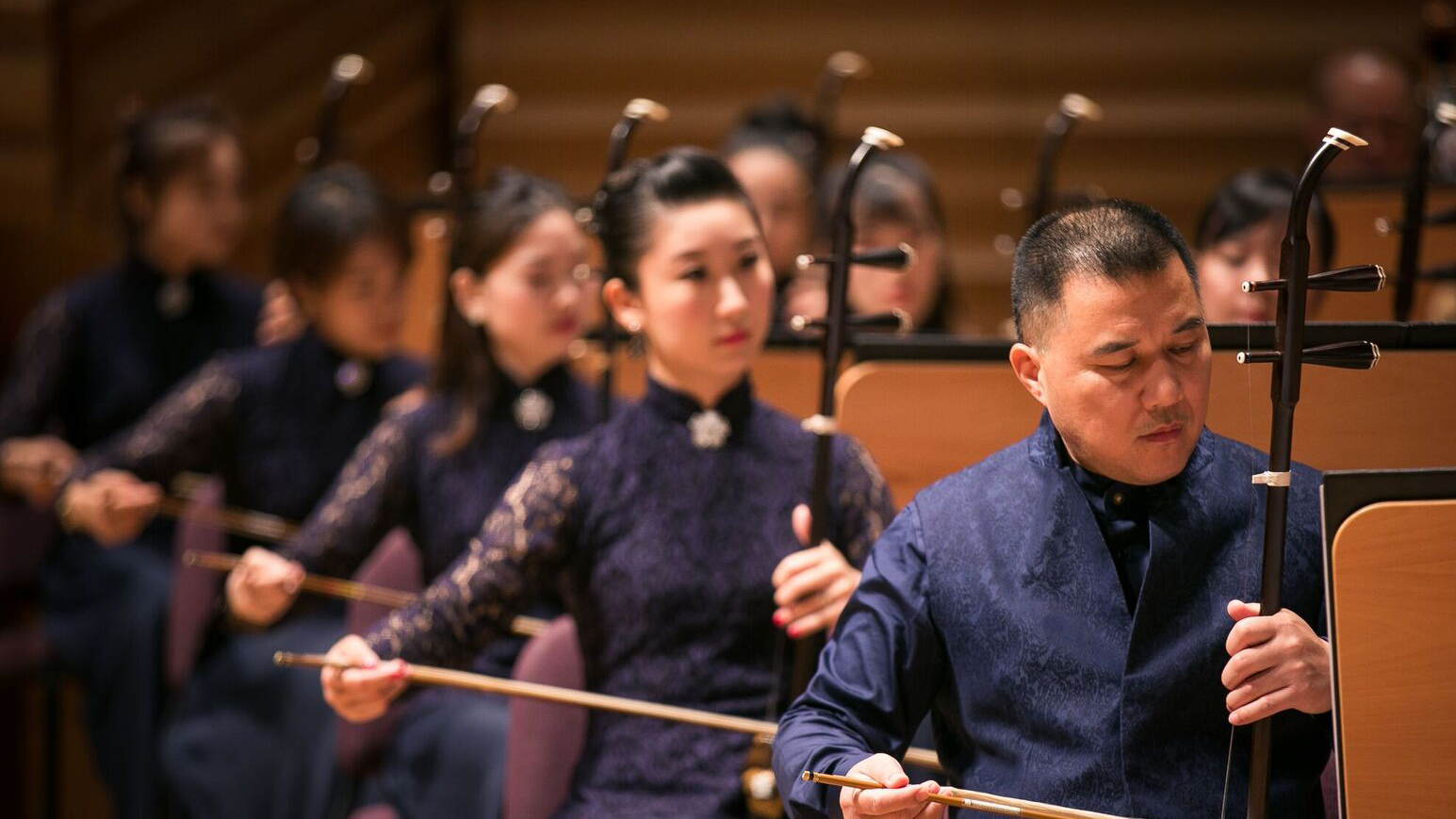 Muhai Tang conducts the Shanghai Chinese Orchestra in a colorful program of traditional Chinese music